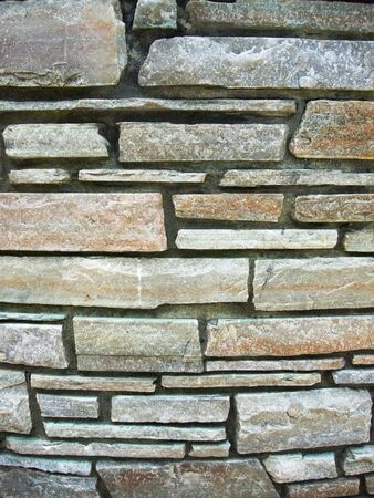 The wall of flagstone brick good for background photo