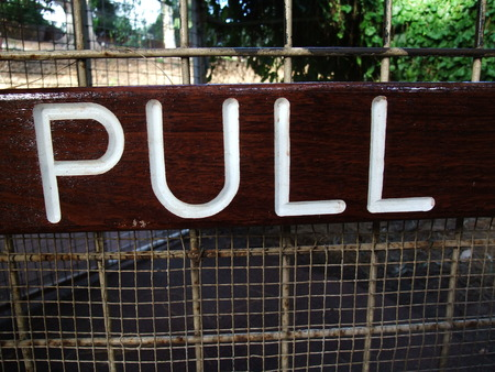 pull: A wooden pull sign panel  on door Stock Photo