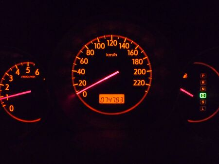 miles: Close up of the car speedometer at night