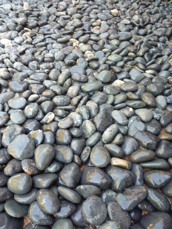 black pebbles: Black and wet pebbles