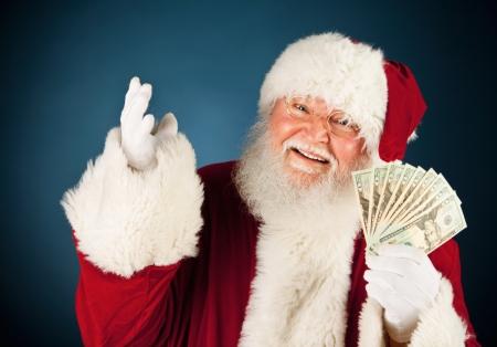man holding money: Extensive series of a Caucasian, Authentic Santa Claus Character on a blue background.