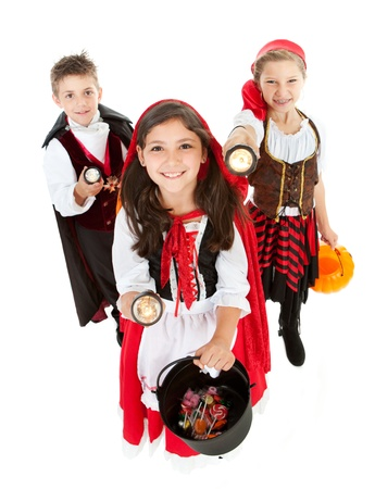 Halloween series with cute children dressed as Dracula, a pirate, and Little Red Riding Hood.  Isolated on white. Banco de Imagens - 22055042