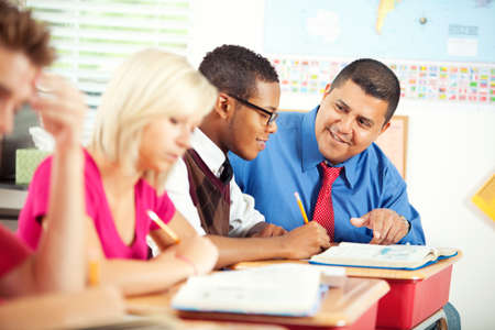 high school series: Extensive series of a multi-cultural group of students with a teacher, in a high school classroom setting. LANG_EVOIMAGES