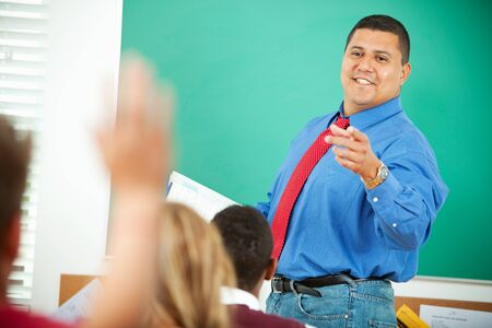 Extensive series of a multi-cultural group of students with a teacher, in a high school classroom setting. Stock Photo