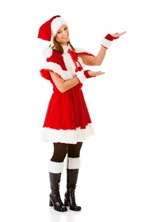 Caucasian female dressed in a cute Santa elf outfit. Standard-Bild