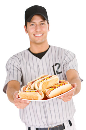 Baseball Player Holds Plate Of Hot Dogs