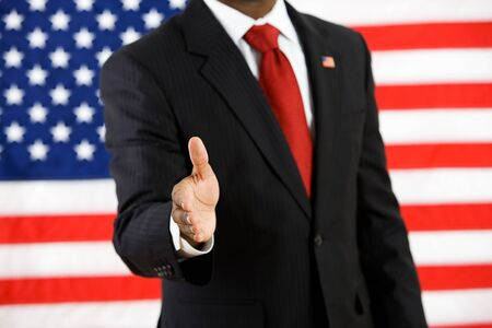 Series with an Anonymous African-American politician in front of United States flag.  A variety of concepts and props, including healthcare, education, wealth and poverty.