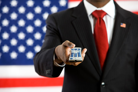 changing channels: Series with an Anonymous African-American politician in front of United States flag.  A variety of concepts and props, including healthcare, education, wealth and poverty.