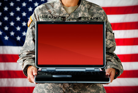 army soldier: Soldier: Laptop with Blank Screen Stock Photo