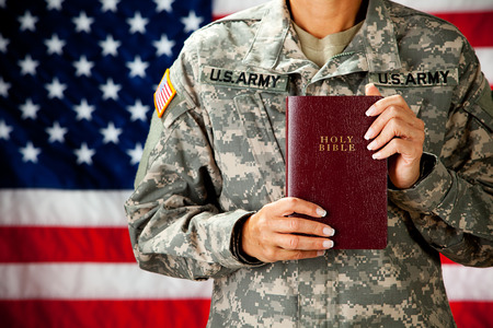 Soldier: Holding a Bible Stock Photo