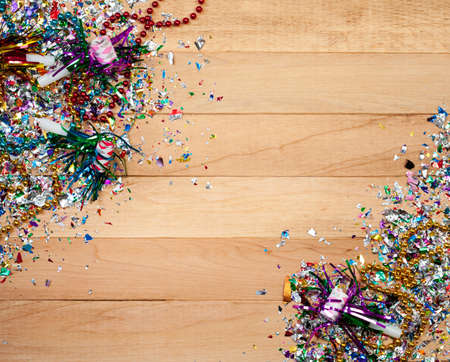 favor: Background series good for New Years Eve - with confetti, champagne, etc. and lots of copyspace on a wooden table setting.
