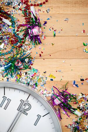 new year eve beads: Background series good for New Years Eve - with confetti, champagne, etc. and lots of copyspace on a wooden table setting.