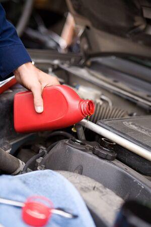 oil change: Mechanic: Doing Oil Change