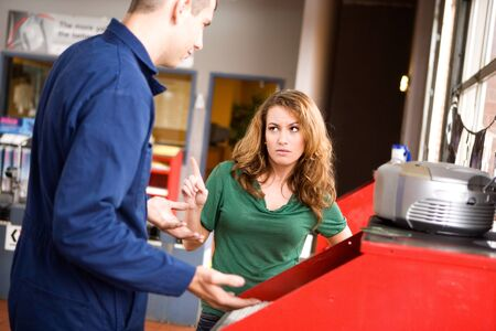 argues: Mechanic: Unhappy Customer Argues With Man Stock Photo