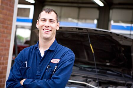 trustworthy: Mechanic: Trustworthy Worker With Truck Behind Stock Photo