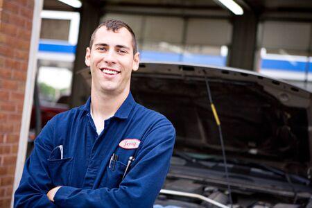 Mechanic: Trustworthy Worker With Truck Behind
