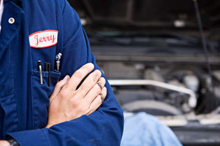 nametag: Mechanic: Close Up Of Dirty Hands And Name Tag