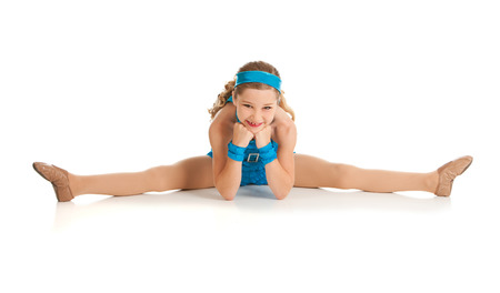 contortionist: Dancer: Dancer Does Straddle Split to Stretch Stock Photo