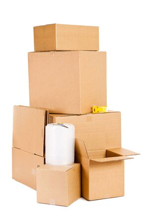 Stack Of Moving Supplies And Cardboard Boxes