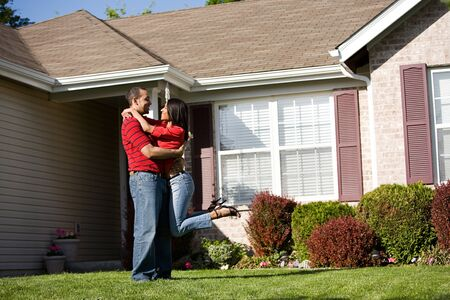 extensive: Extensive series of a Caucasian Real Estate Agent and African-American Couple in front of a home.