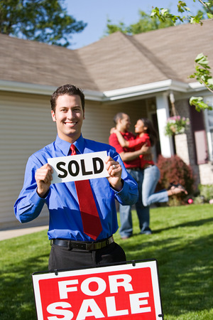 sold sign: Home: Real Estate Agent with Sold Sign