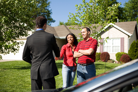 Home: Couple Meets with Real Estate Agent