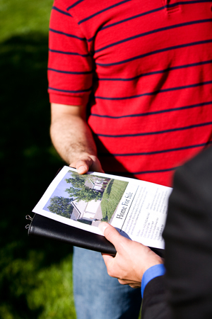 homebuyer: Home: Looking at a Home Brochure Stock Photo