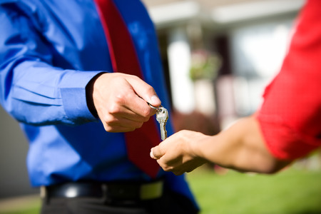 homebuyer: Home: Agent Hands Over New House Keys Stock Photo