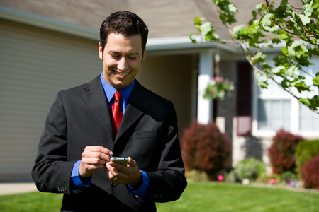 Home: Calling the Office About House Stock Photo