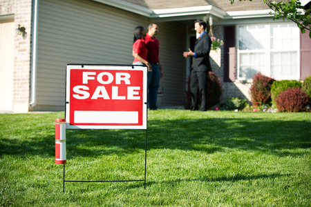 homebuyer: Home: For Sale Sign with Agent and Couple in Back