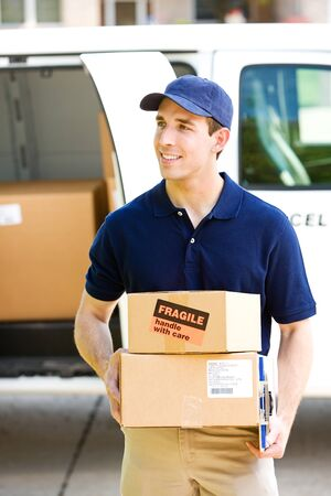 Delivery: Carrying Boxes to Front Door Stock Photo
