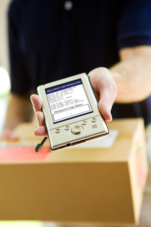 handheld device: Delivery: Waiting for a Digital Signature