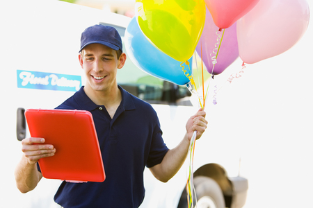 Delivery: Man Taking Balloons to House