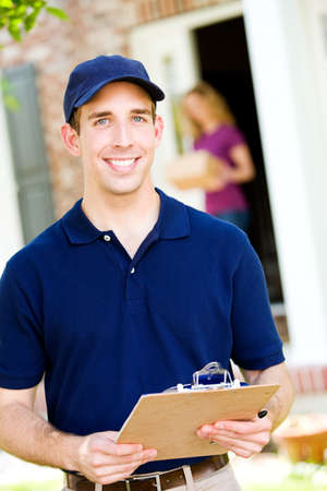 Delivery: Cheerful Delivery Man Stock Photo