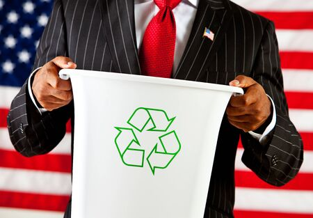 environmental issues: Politician: Holding Recycle Bin