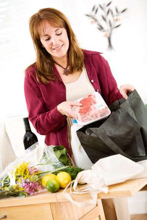 reusable: Reusable: Unpacking Groceries From Environmentally Green Bag