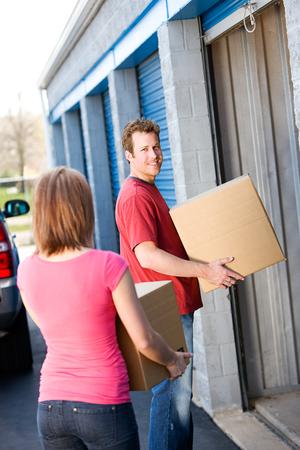 Storage: Man Putting Stuff in Storage Standard-Bild