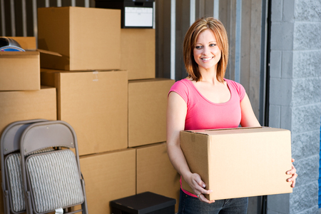 Storage: Woman with Boxes Behind Stock Photo