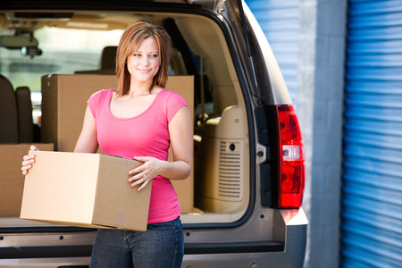 storage unit: Storage: Woman Lifts Box from Truck