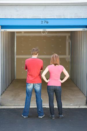 storage unit: Storage: Couple Looking at Empty Unit