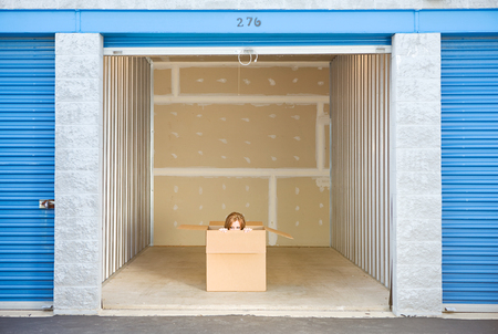 storage: Storage: Woman Peeking To Side Out of Box in Unit