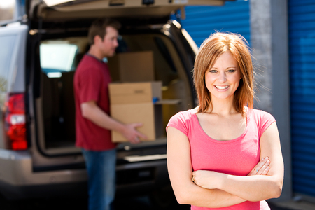 Storage: Woman with Truck Full of Boxes Standard-Bild