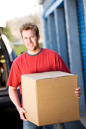 storage box: Storage: Man Taking Box to Storage
