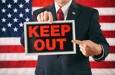 keep out: Politician: Man Pointing To Keep Out Sign Stock Photo