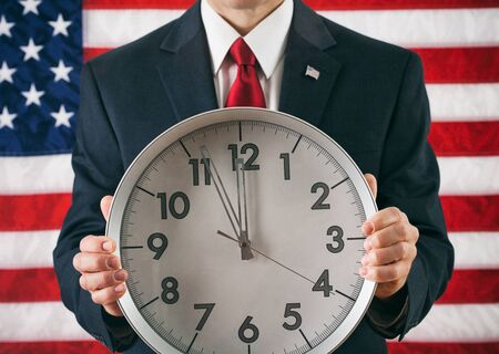 politician: Politician: Man Holding Clock Close To Midnight