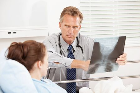 hospital patient: Hospital: Doctor Having Serious Discussion with Patient