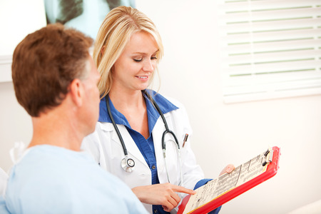 reviews: Hospital: Doctor Reviews Exam Results with Patient