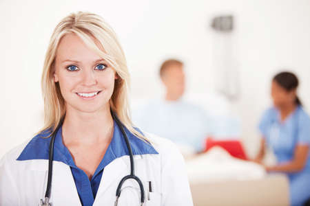 hospital patient: Hospital: Cheerful Doctor with Patient Behind