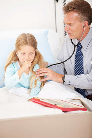 coughing: Hospital: Girl Coughing for Doctor Stock Photo