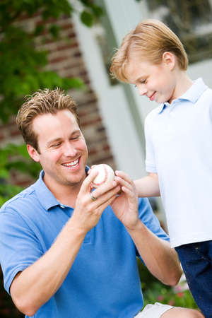 teaches: Summer: Dad Teaches Boy About Pitching